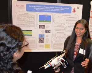 ivya Srivastava, a sophomore in the School of Engineering, explains her research project at this summer's public poster session.