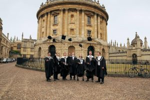 Students celebrate after graduating from Oxford.