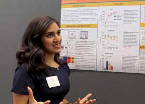 A student presents a poster during the Texas Clark Scholars Program.