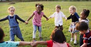 Children dancing in the grass.