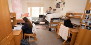 Two Yale roommates gather together in their dorm.