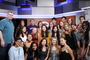 High school students attending the program visit a news station to learn