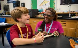 A mentor teaching a student a STEM related topic.