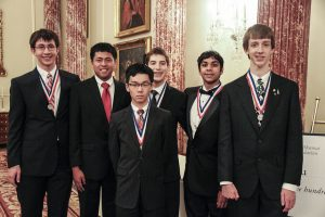Students posing for the International Math Olympiad.