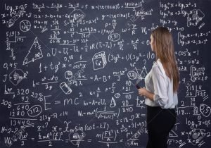 A girl solving a Math problem on a blackboard
