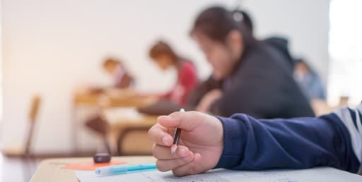 Students taking a test in a room