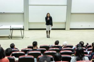 Host speaking in front of the students