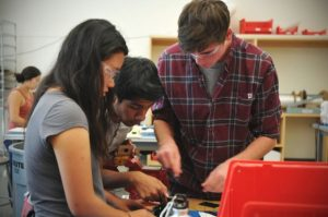 Three students working on a project.