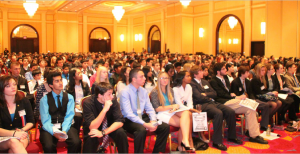 Participants of the JCA convention in an event hall.