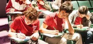 Students answering a test in a room