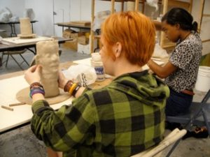 Students doing a sculpture
