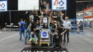 Participants of the competition showing off their robot