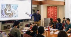 A professor teaching students in the Stanford Humanities Center