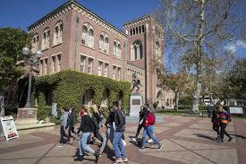 Students walking in front of the USC school building