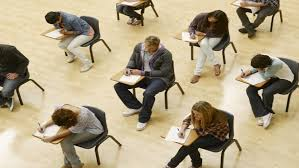 Students taking a test in the exam hall