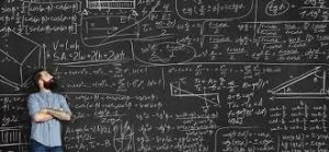 A man with a board with Math formulas written all over it.