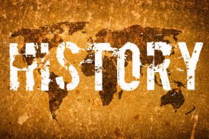 An image with the word history and a world map as background
