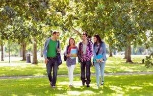 Santa Clara University students walking in the school grounds