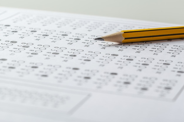 Pencil and test paper on the table