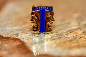 Thespian Society pin in a table