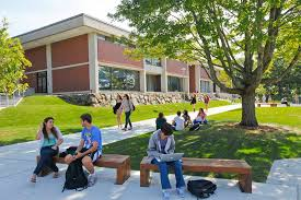 Students lounging in the benches of the campus