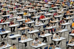 Students answering a test in a hall