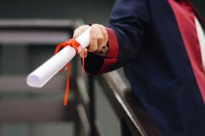 A diploma with red ribbon