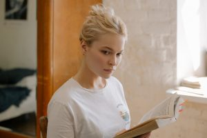 Blond girl holding a book