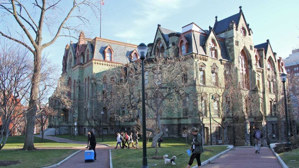 UPenn school campus with students walking around.