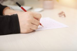 Test paper and a pen in a table.