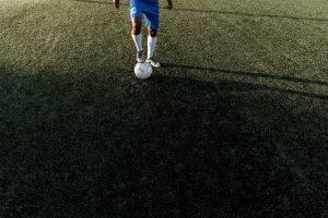 Young man playing soccer.