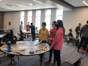 Students working on a project in a room.