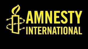 Amnesty International logo in yellow and black.