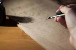 Writing in a brown paper on a table.