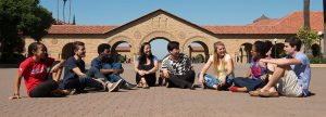 Students sitting on the ground of the