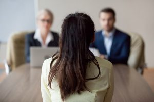 A woman interviewed by college admissions personnel.