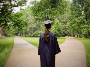 A student wearing a graduation gown.