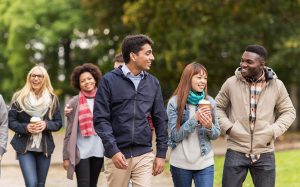 Students from different countries walking in the university grounds.