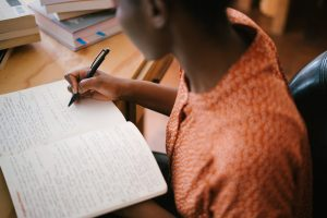 Young girl writing in her notebook.