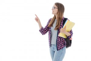 Young ivy league student holding her books and backpack.