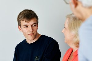 young man talking to his parents