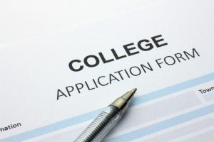 Application form with a pen on top.