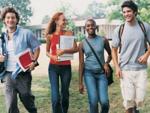 Student with different races walking in the school grounds.