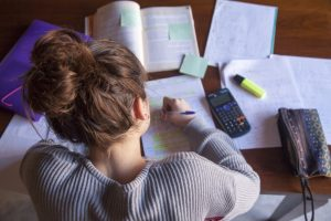 Young woman studying for SAT exam.