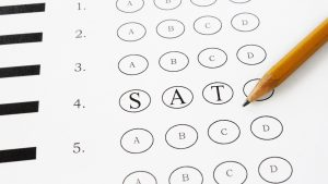 Test paper with the word SAT written on it.