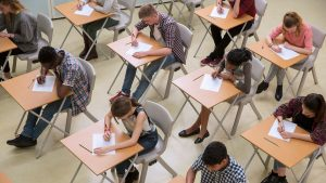 Students taking an exam in a room.
